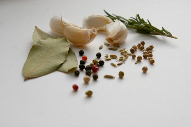 Herbs and spices laid out on a surface