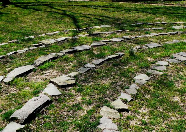 Stones set into grass to form a Labyrinth
