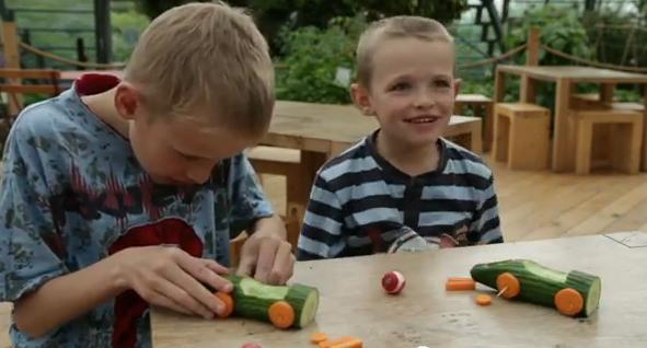 Children making vegetable lego