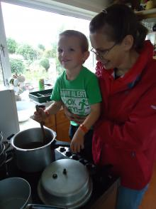 Mother and child making soup