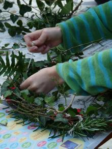 Tying cuttings onto a home made wreath